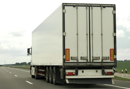 single white truck on the highway (rear view) photo