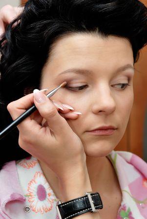 eyelid: Make-up. Putting eye shadow on eyelid with brush