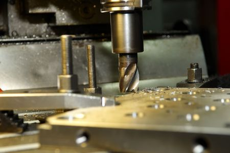milling center: End-tooth vertical mill cutting the metall blank