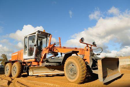 grader: road grader bulldozer over blue sky outdoors