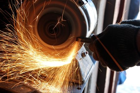 metallurgy: Manual sharpening of a tool on grinding machine Stock Photo