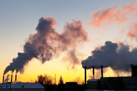 emitting: air pollution with columns of smoke emitted from factory chimneys