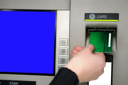 Cash withdrawal. Womans hand inserting plastic card Visa into the ATM photo
