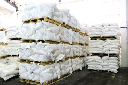 food distribution: storehouse with stacked sacks of meal