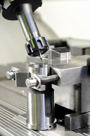 milling center: Thin mill cutting the metal blank fixed in attachment Stock Photo