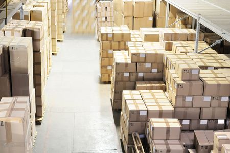 storage compartment: Rows of cardboard boxes in warehouse Stock Photo