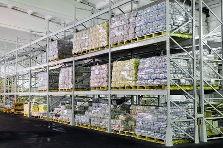 food distribution: Pile of food production stacked in warehouse shelves Stock Photo