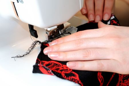 two woman hands sewing on the stichting machine Stock Photo - 6250545