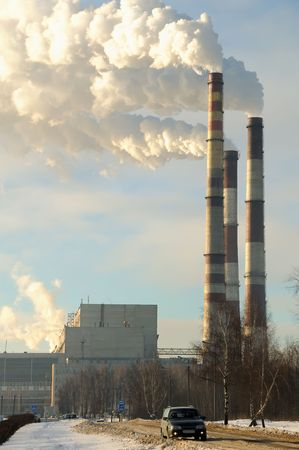 smoking chimneys of supply station power plant over blue sky Stock Photo - 6250544