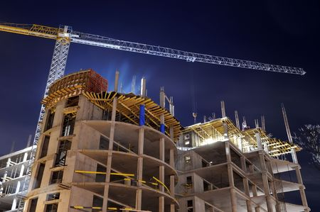 monolithic: night shot of construction equipment at building site Stock Photo