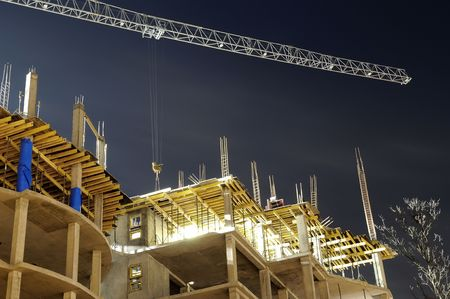 concrete form: night shot of construction equipment at building site Stock Photo