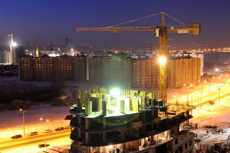 night shot of construction building site with tower cranes Stock Photo - 6250596