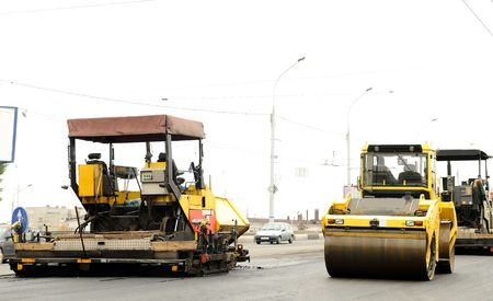 roller compactor: road construction equipment machinery at street building repairing