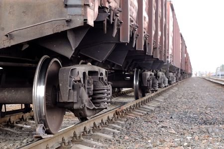 freight traffic: railway road and close up view from lower camera angle of freight cargo train