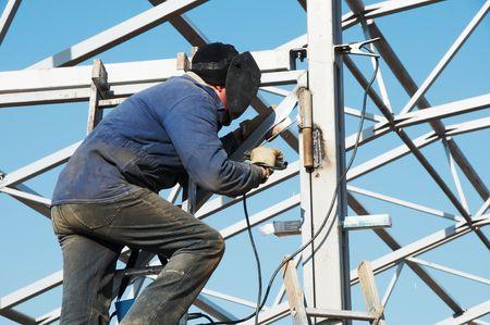 electrode: Man welder working welding with electrode outdoors