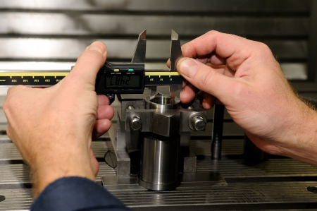 micrometer: Check measurement of a bore in a metal blank in attachment by hand caliper