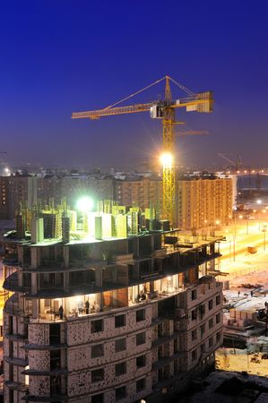 night shot of construction building site with tower crane loader Stock Photo - 6419122