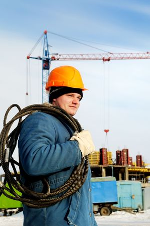 construction worker in front of building site at winter  photo