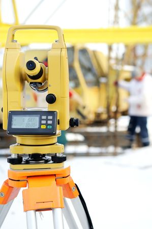 exact position: Land surveyor equipment theodolite at a construction site in winter Stock Photo