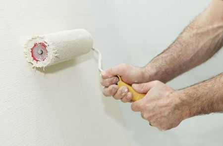 Painter worker hand at decoration work painting a wall with roller Stock Photo - 6504335
