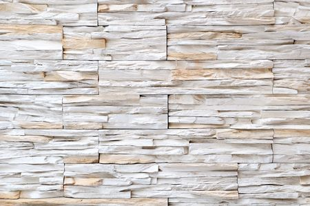 rigidity: Yellow white brick stone exterior and interior decoration building material for wall finishing Stock Photo