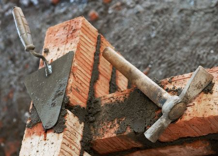 pecker: Construction equipment for brick building work Stock Photo