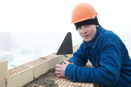 A brick layer worker building a brick wall at construction site Stock Photo - 6786820