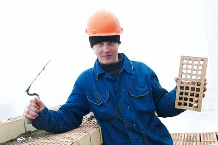 A brick layer worker building a brick wall at construction site Stock Photo - 6786817