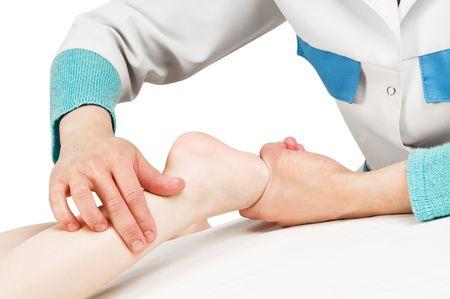 Masseur making a massage to child leg and foot  photo