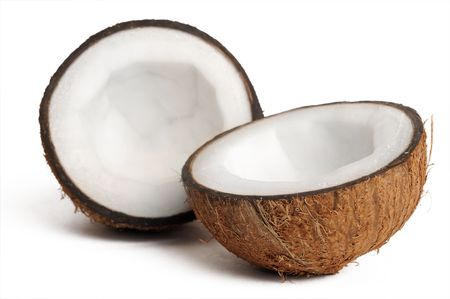 fruit drop: two halfs of coconut isolated on white with shadow