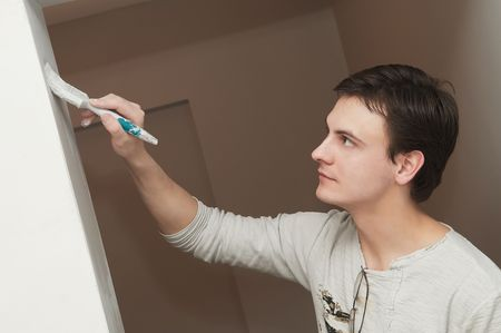 Painter worker hand at decoration work painting a wall with brush Stock Photo - 7156214