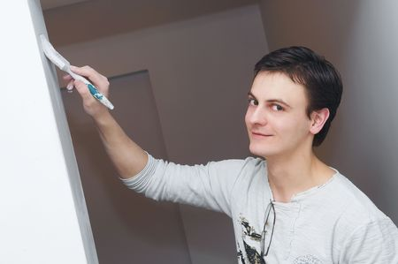 Painter worker hand at decoration work painting a wall with brush Stock Photo - 7156216