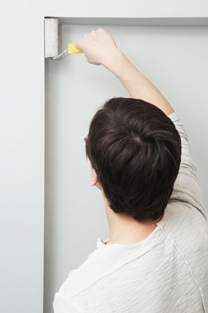 Painter worker at decoration work painting a wall with roller Stock Photo - 6806417