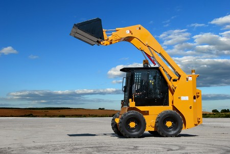 equipment: skid steer loader construction machine with bucket outdoors