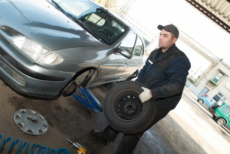 taking off tyre from car for repair work (replacement) photo