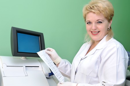 woman medic doctor in uniform examining blood test result photo