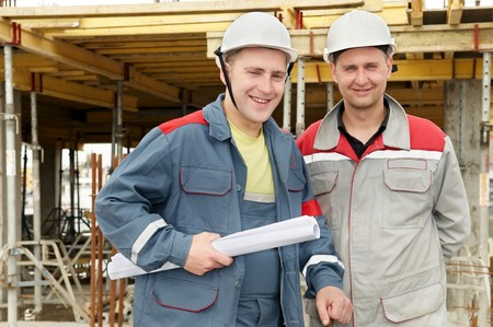 Two engineer builders with blueprint at construction site Stock Photo - 7397810
