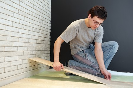 Young worker carpenter laying a floor with laminated flooring boards  Stock Photo - 7398098