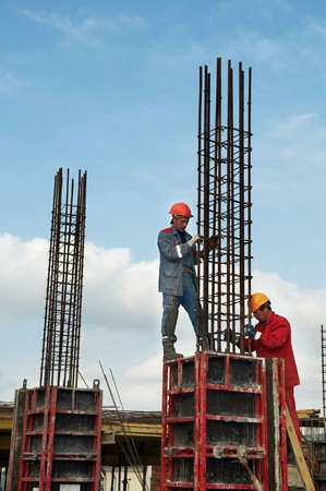 erector: two construction workers installing reinforcement for concrete Stock Photo