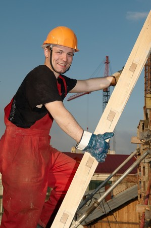 mounter: Young happy smiling worker builder at construction site