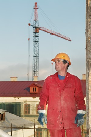 mounter: handsome adult worker building at construction site