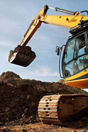 Loader Excavator standing in sandpit with risen bucket over cloudscape sky  Stock Photo - 7398159