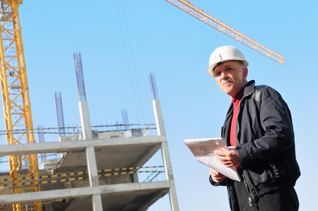 inspector: positive builder inspector worker at construction site Stock Photo