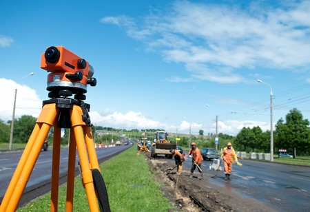 surveyor: equipment theodolite tool at construction site works in summer Stock Photo