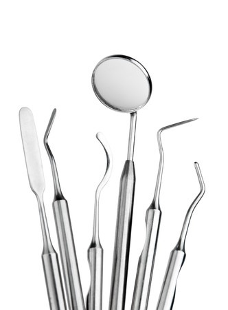 a dentist: Set of metal medical equipment tools for teeth dental care