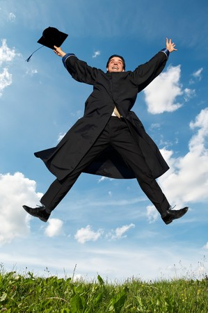 Young smiley graduate student in gown jumping over blue sky Stock Photo - 7399911