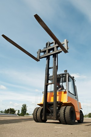 service lift: Heavy Forklift loader for warehouse works outdoors with risen forks
