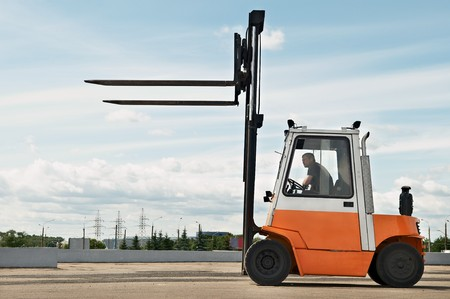 service lift: Forklift loader for warehouse works outdoors with risen forks