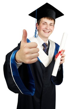Young smiley graduate student in cloak with diploma and thumbs up isolated photo