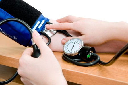 taking an arterial blood pressure by medical equipment tonometer photo